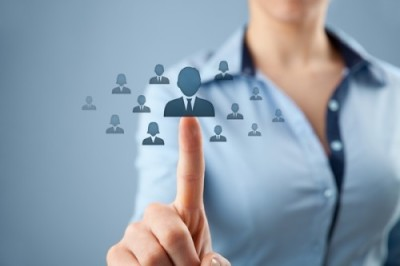 Human resources, CRM and social networking concept - female officer choose person (employee) represented by icon.